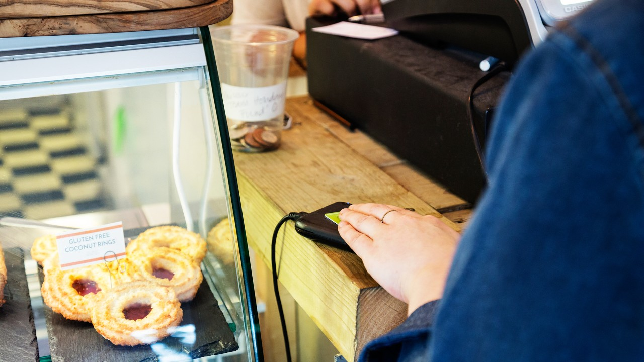 Using contactless payment at the cafe