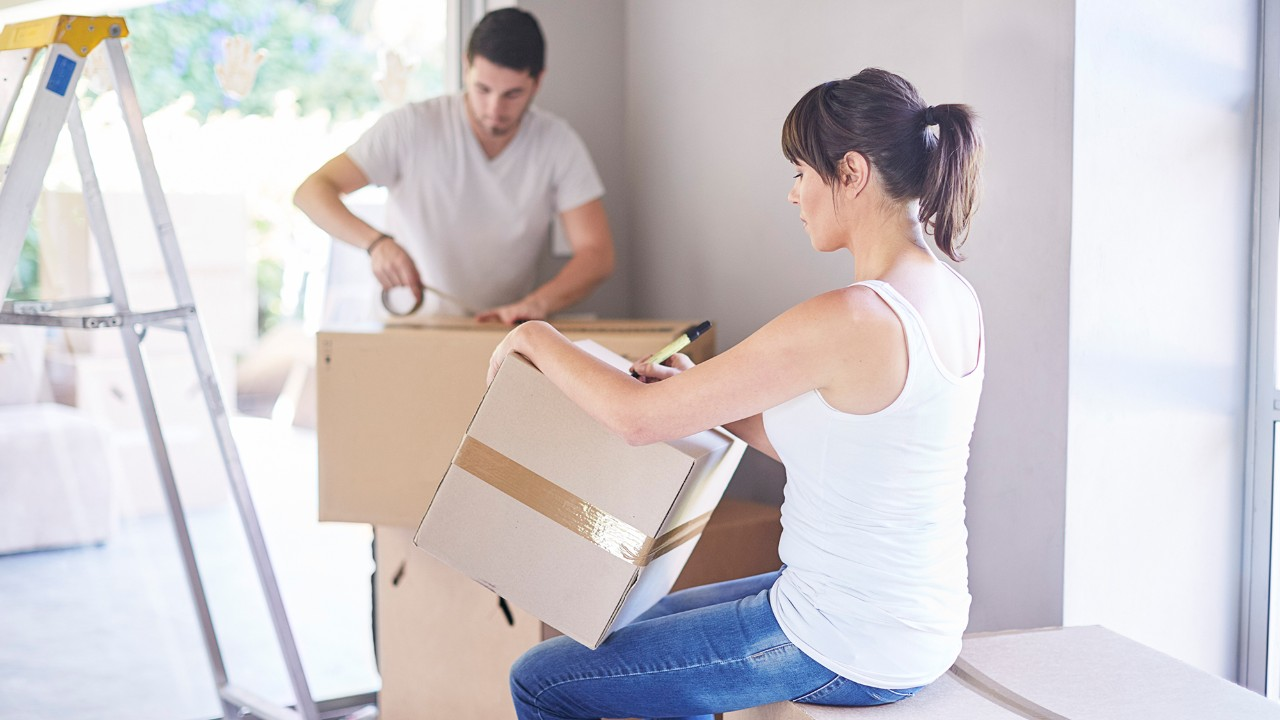 Couple moving home and packing