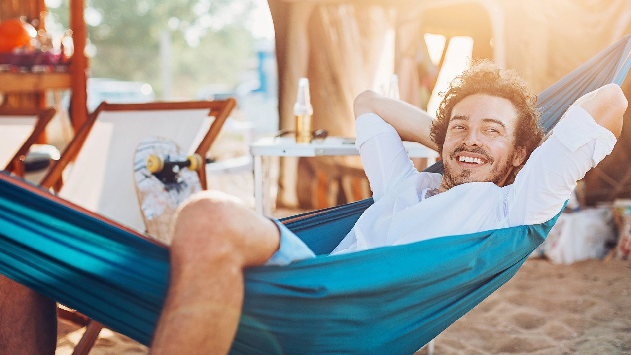 a men is lying in a hammock