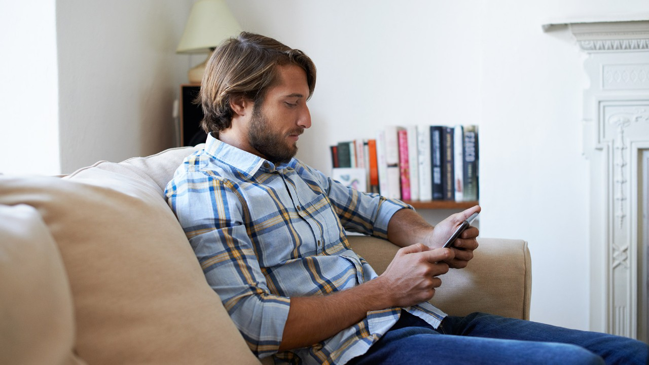 Man using tablet at home