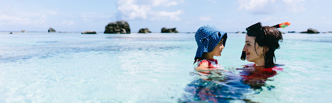 mom snorkelling with daughter