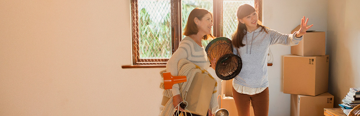 mother and daughter moving in house