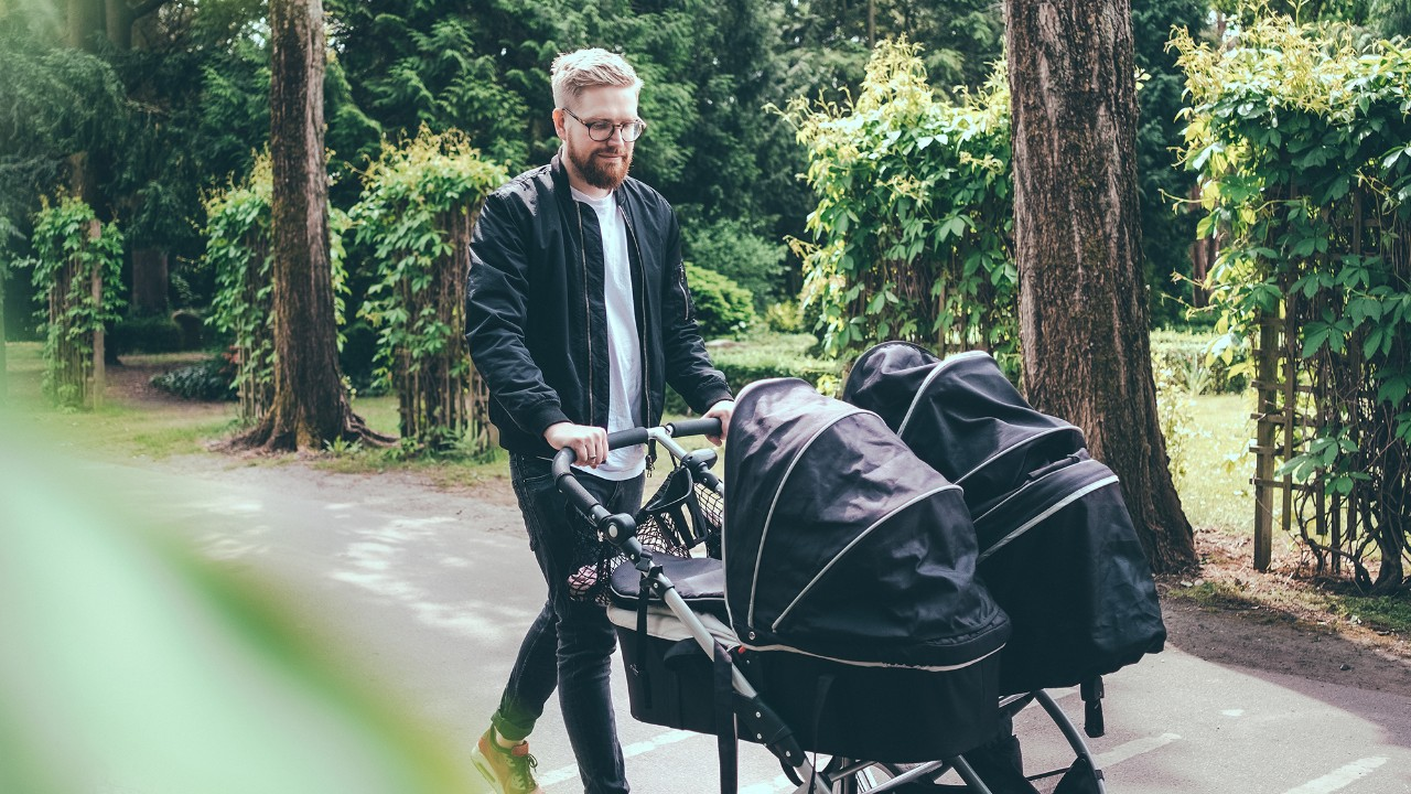 man pushing a stroller outside