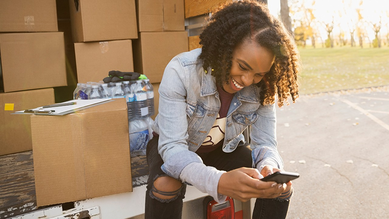Young lady packing boxes
