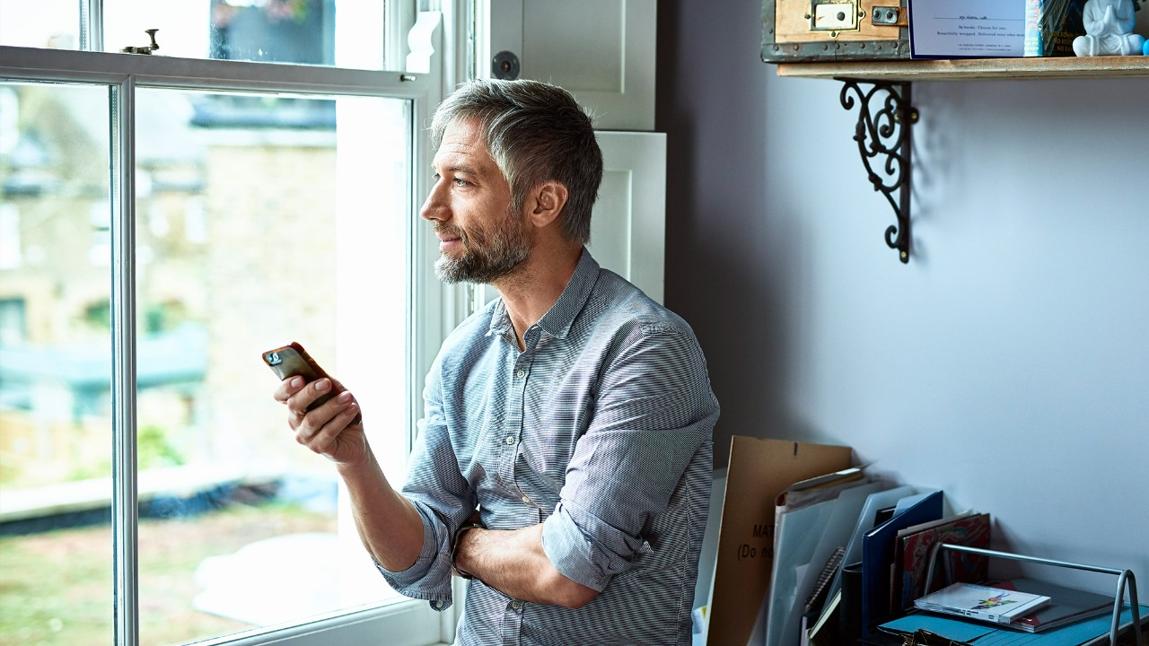 Man on phone at window