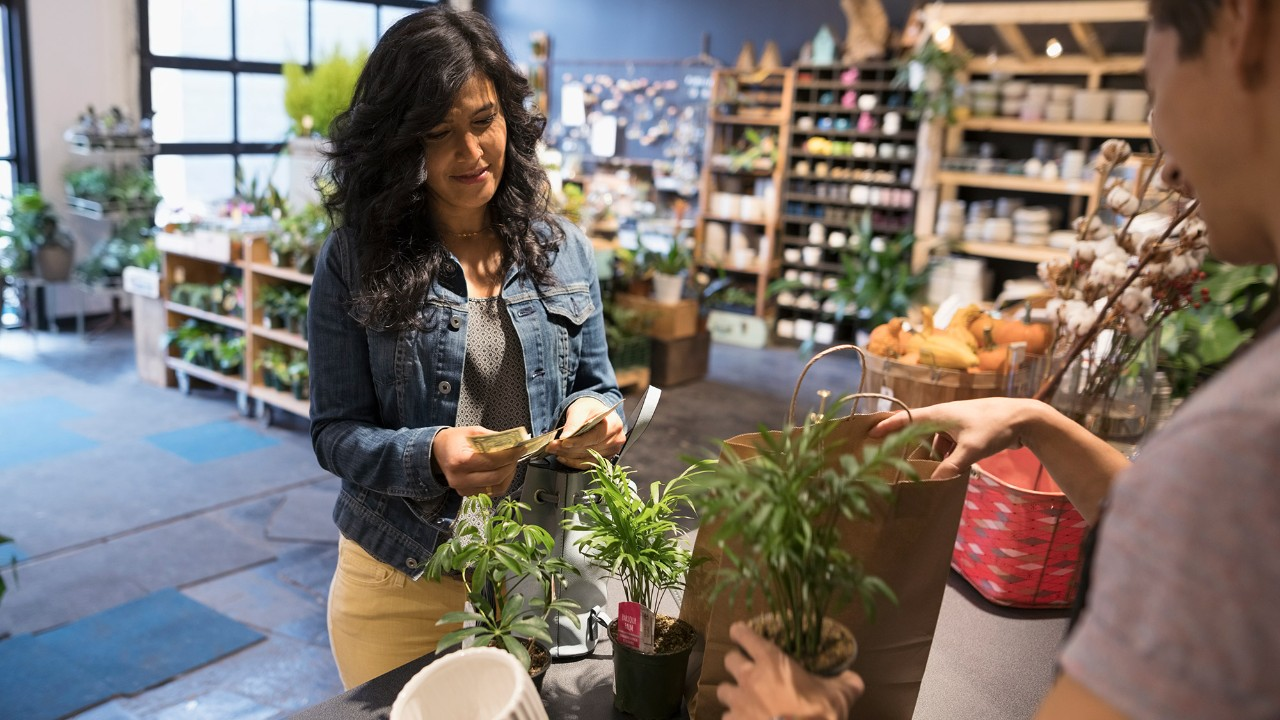 Woman buying plants overseas
