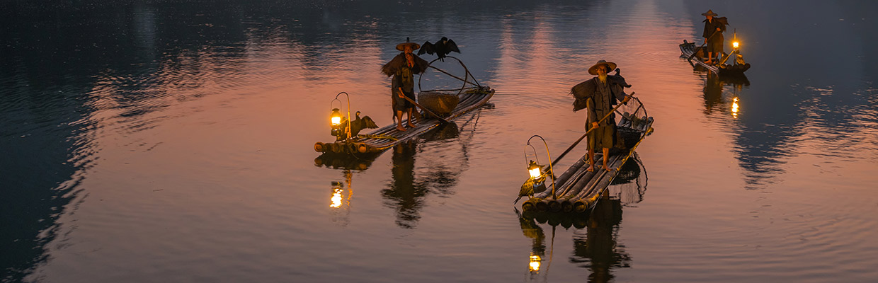 fisherman at dawn on river