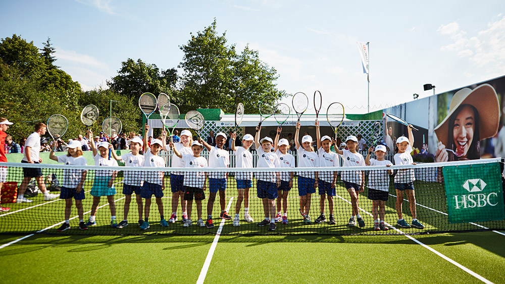 Group of kids with tennis rackets